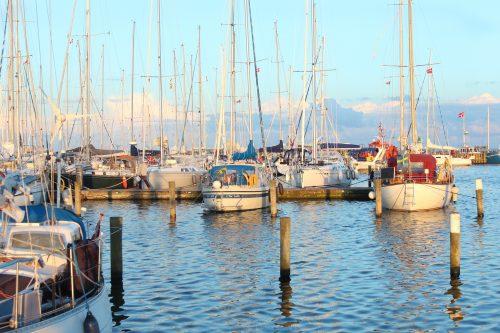 boats water sky sunset warm masts grenaa denmark