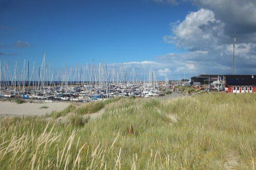 Læsø Denmark sky blue water boats grass
