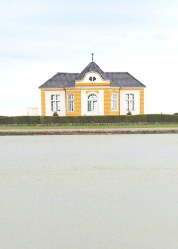 troense svendborgsund orangeries building yellow water sky sun houses