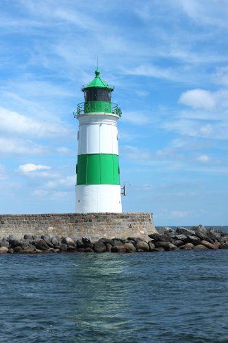 schlei maasholm buildings lighthouse green stripes water sky blue germany